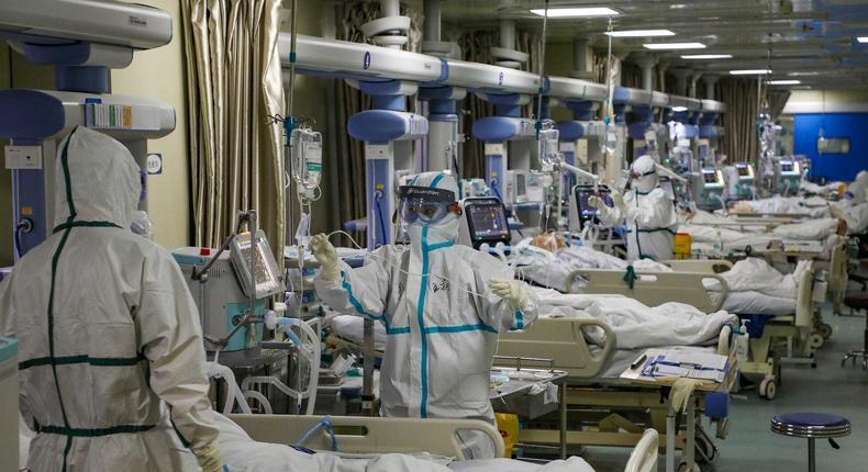 Medics attending to intensive care unit (ICU) patients