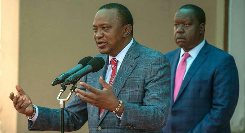 File image of interior CS Fred Matiangi with President Uhuru Kenyatta