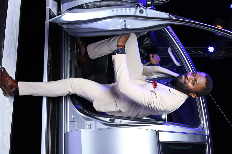 Actor, Ozyy Agu, posing  with the new Mitsubishi L200