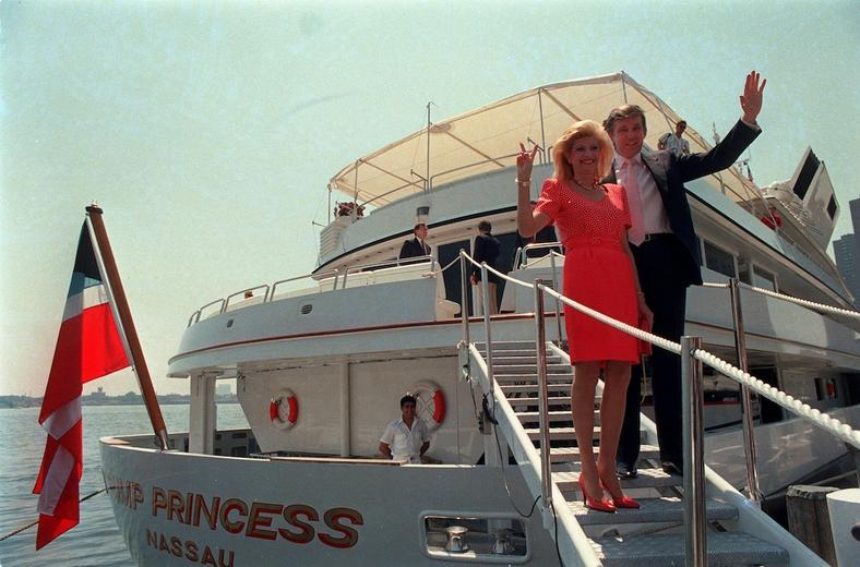 "Donald Trump waves to reporters with his wife, Ivana, as they board their yacht, ""The Trump Princess,"" in New York in 1988."