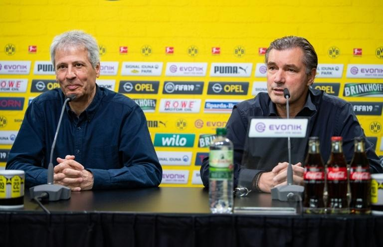 Coach Lucien Favre (L) and sporting director Michael Zorc (R) are hoping that Dortmund can snatch the Bundesliga title on Saturday