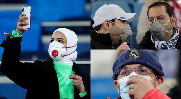 Navijači sa maskama gledaju utakmicu Real Madrid - Mančester siti