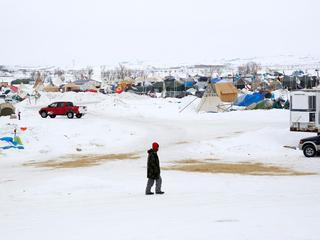 A man walks through the Dakota Access Pipeline protest camp on the edge of the Standing Rock Sioux R