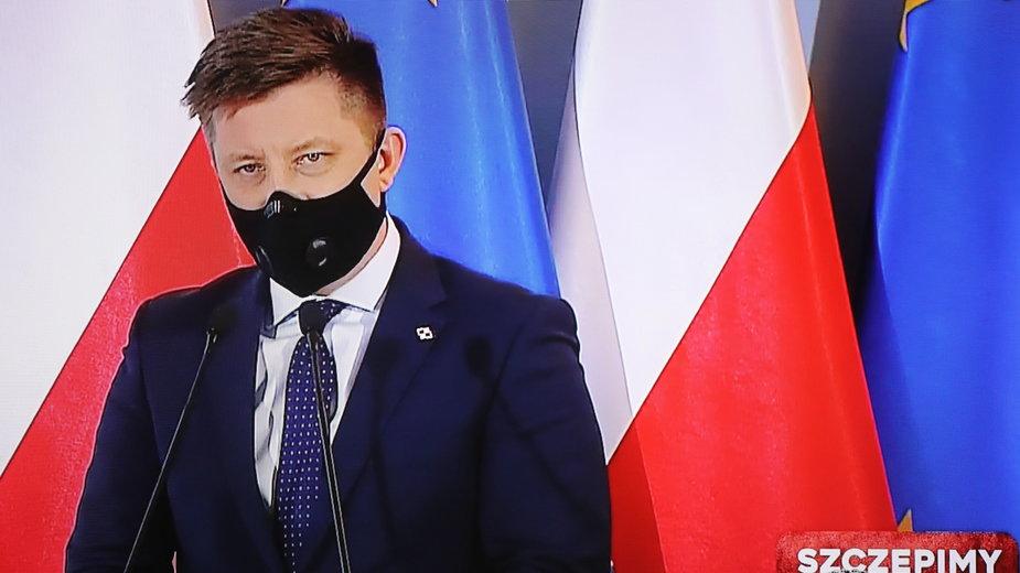 Szef KPRM Michał Dworczyk na konferencji ws. narodowego programu szczepień na koronawirusa