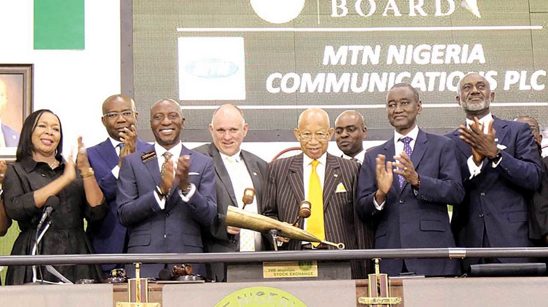 Member, National Council Member, Nigerian Stock Exchange (NSE), Mrs. Erelu Angela Adebayo (left); Ex-Officio, NSE, Aigboje Aig-Imoukhuede; Chief Executive Officer, NSE, Oscar Onyema; Chief Executive Officer, MTN Nigeria Communication Plc, Ferdi Moolman; Chairman, MTN Nigeria Communication Plc, Dr. Pascal Dozie; Chief Executive Officer, Chapel Hill Denham, Bolaji Balogun; First Vice President, NSE, Abubakar Balarabe Mahmoud; and Director, MTN Nigeria Communication Plc, Gbenga Oyebode, during the Listing of MTN Nigeria Communications Plc on the Premium Board of NSE in Lagos (Guardian Nigeria)
