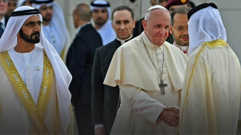 Dubai ruler Sheikh Mohammed bin Rashid Al-Maktoum accompanies Pope Francis as he meets dignitaries during a welcome ceremony in Abu Dhabi on February 4, 2019