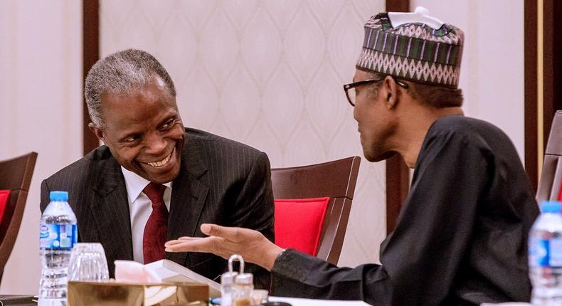 Vice President, Yemi Osinbajo, and President Muhammadu Buhari discuss a t a meeting at the State House on August 28, 2018