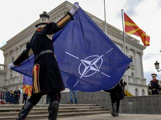 NATO flag hoisted alongside Macedonian flag at government building in Skopje