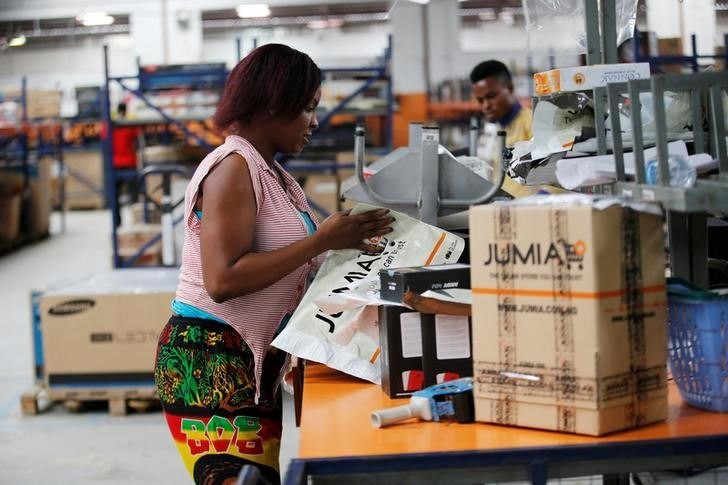 A woman works at the packaging unit at a warehouse for an online store, Jumia in Ikeja district, in Nigeria's commercial capital Lagos June 10, 2016.