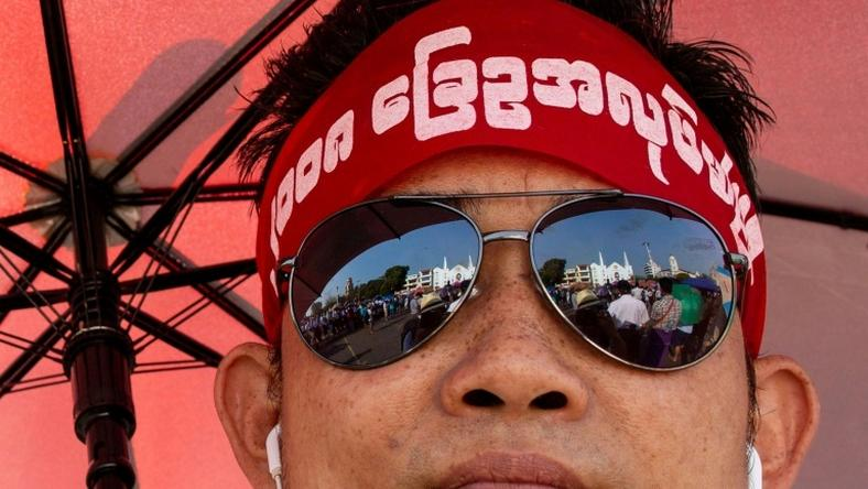 The rally drew hundreds wearing headbands and T-shirts calling for reform of the military-scripted constitution