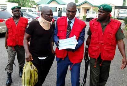EFCC operatives leading fresh suspects in the N8 billion CBN staff fraud to the court premises in Ibadan, Oyo State