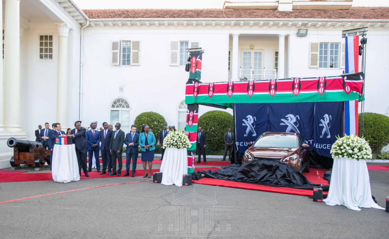President Uhuru Kenyatta and his French counterpart President Emmanuel Macron took a ride inside a brand-new Peugeot 3008 at the Statehouse during the unveiling ceremony of the newly assembled Sports Utility Vehicle (SUV).
