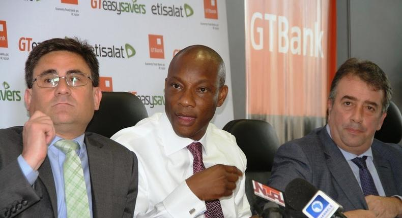 L-R CMO of Etisalat Nigeria, Angelone Francesco, MD/CEO of GTBank, Mr Segun Agbaje and an official of Etisalat Nigeria during the launch of Easysavers.