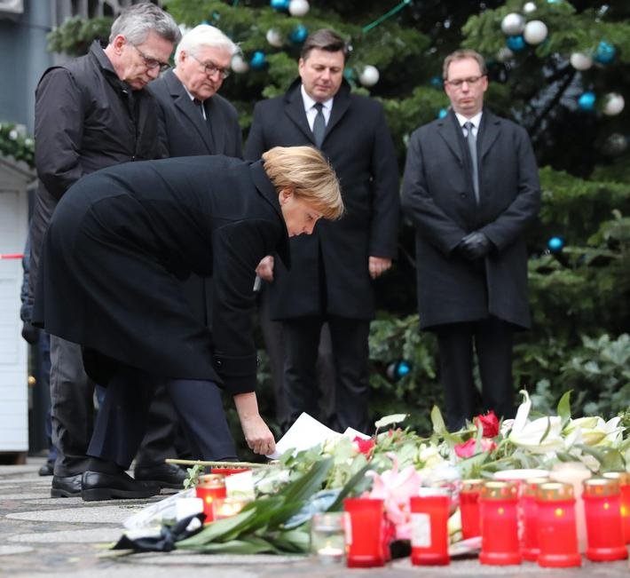 Chancellor of Germany, Angela Merkel visits the scene of an attack at a Christmas market in Berlin