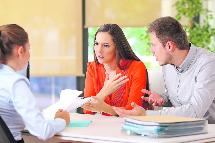 stock-photo-angry-couple-arguing-telling-their-problems-sitting-in-a-desktop-of-a-marriage-counseling-or-office-662353858