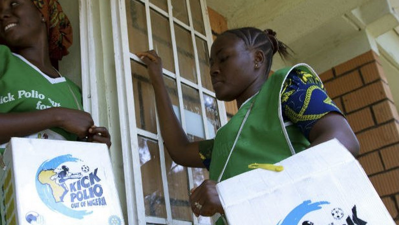 Health officials go from house to house to immunise children against polio (Leadership)