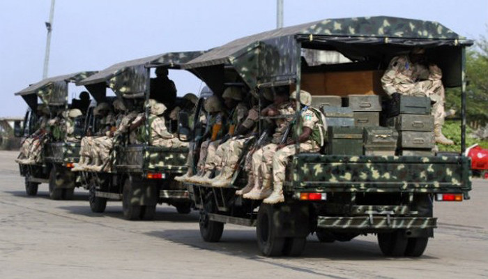 Nigerian army troops after a successfully  raids - Champion Newspapers
