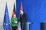 AV i Merkel