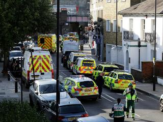 Police vehicles line the street near Parsons Green tube station in London