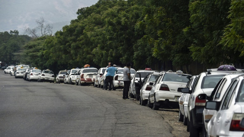 Drivers lining up to buy gasoline in crisis-hit Venezuela, close to the border with Colombia, where the US military is shipping another 200 tons of military aid