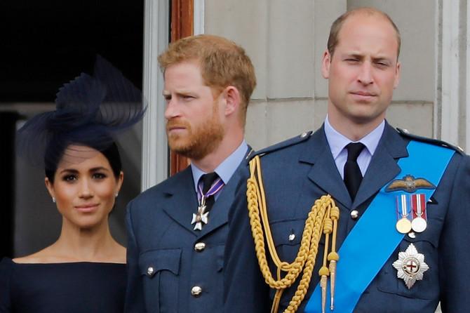 Megan Markl i prinčevi Hari i Vilijam na balkonu Bakingemske palate u julu 2018.