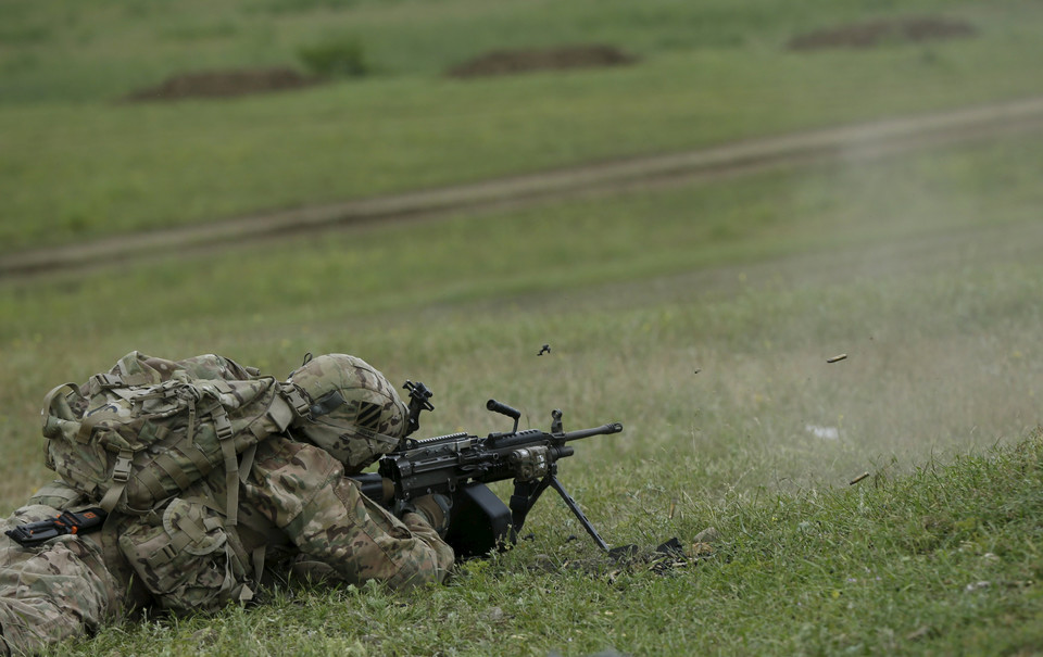 A U.S. serviceman fires his weapon during the joint U.S.-Georgian exercise Noble Partner 2015 at the Vaziani training area outside Tbilisi