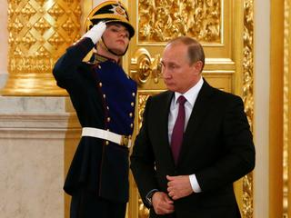 Russia's President Putin arrives for a ceremony of receiving diplomatic credentials from foreign amb