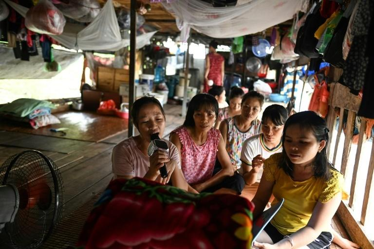For many Vietnamese migrant workers living on Hanoi's Red River, the camaraderie that comes with selling fruit brings fragments of comfort