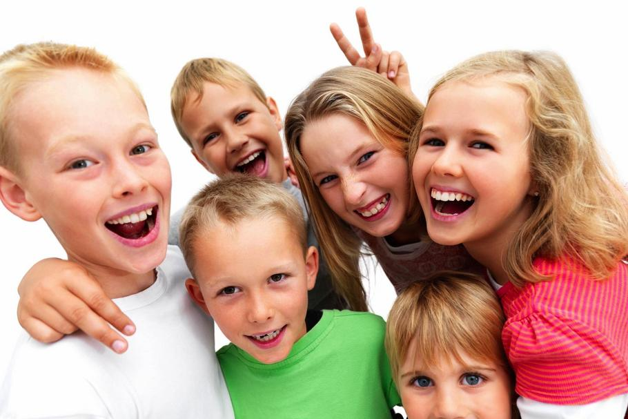 Group of excited young children laughing