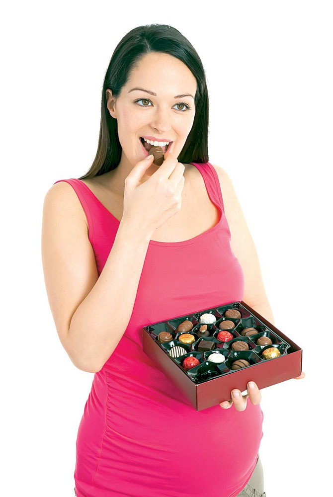 36027_stock-photo-pregnant-woman-eating-a-box-of-chocolates-shutterstock_73150936