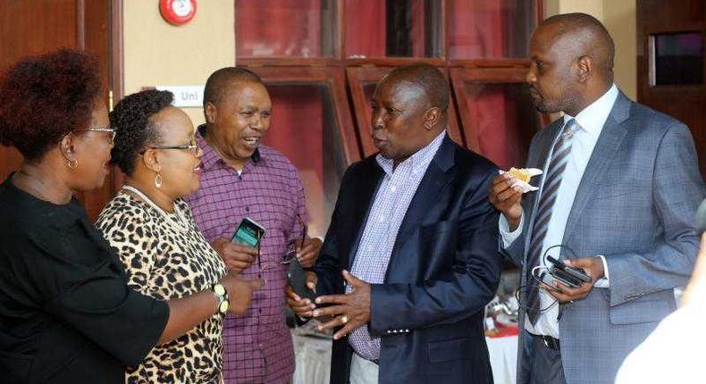 File image of Maina Kamanda (in black coat) with fellow leaders at a past function He has warned that the Mt Kenya region may form a coalition with other communities