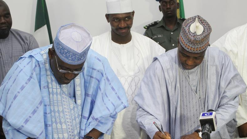 L-R: Ag Managing Director of Bank of Industry, Mr. Wahid Olagunju and Sokoto State Governor, Aminu Waziri Tambuwal, signing an agreement to provide N2billion to SMEs in Sokoto. Middle of Deputy Governor Ahmed Aliyu.