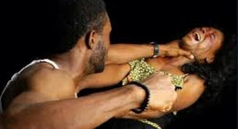 A man beating up a woman
