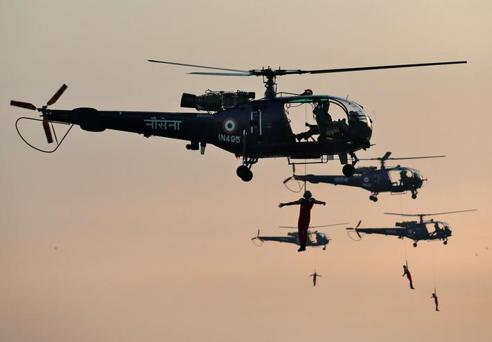 Indian Navy marine commandos demonstrate their skills during a rehearsal ahead of Navy Day celebrati