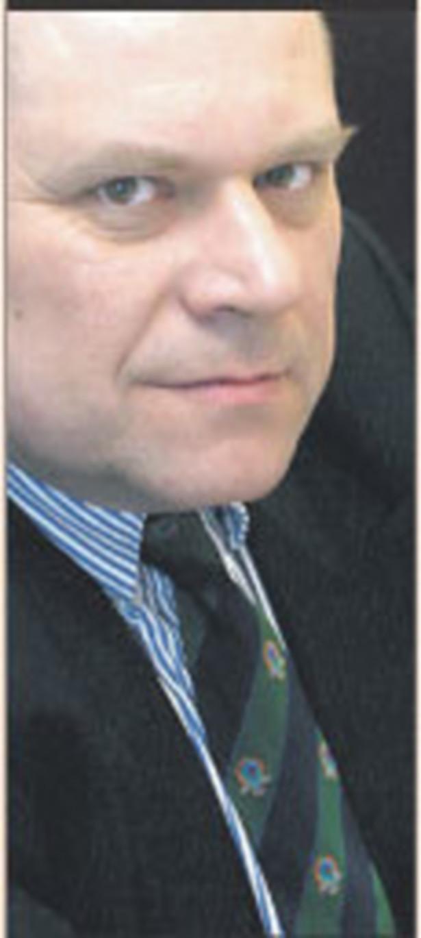 dr Janusz Fiszer, partner White & Case, docent UW
