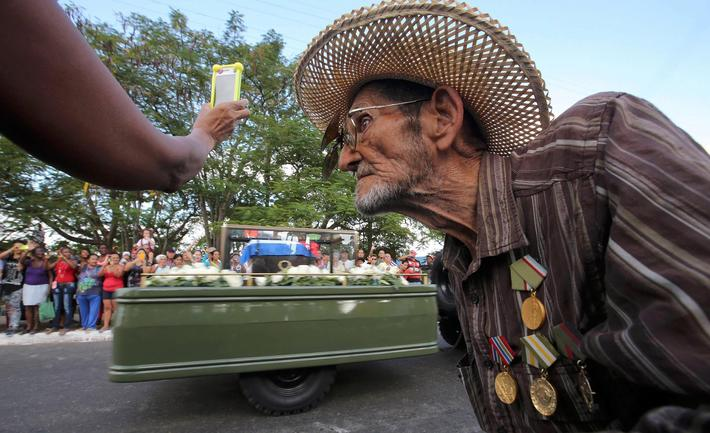 Guillermo Enrique Cadiz, 82, who fought with Fidel Castro in the Sierra Maestra, watches as Castros
