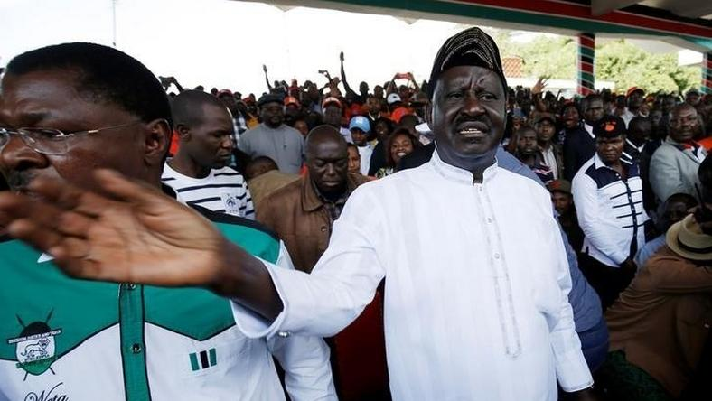 Leaders of Kenya's opposition Coalition for Reforms and Democracy (CORD), Raila Odinga (R) and Moses Wetangula (L) arrive at a rally to mark Kenya's Madaraka Day, the 53rd anniversary of the country's self rule, at Uhuru Park grounds in Nairobi, Kenya, June 1, 2016. REUTERS/Goran Tomasevic