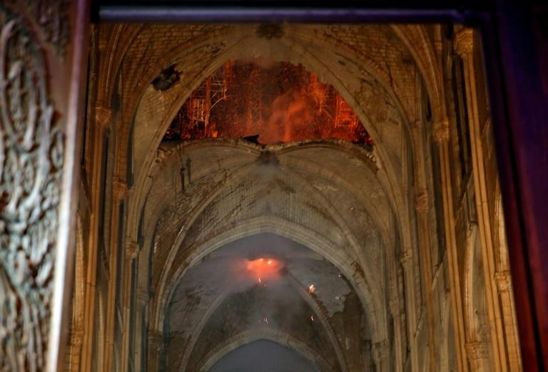 Flames inside the Notre-Dame cathedral of Paris as firefighters fought the blaze Monday night