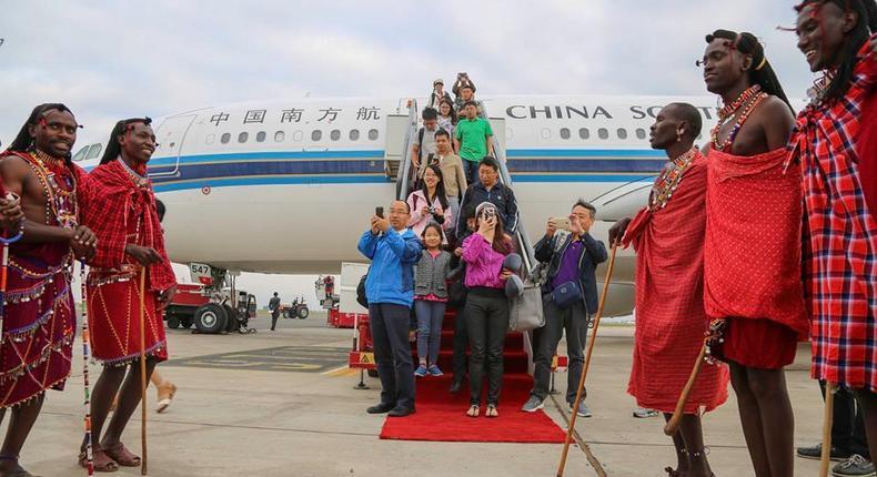 Traditional Kenyan Masaai dancers welcome Chinese tourists disembarking from a China Southern Airline plane at Jomo Kenyatta International Airport ( JKIA). (aviationtanzania.)