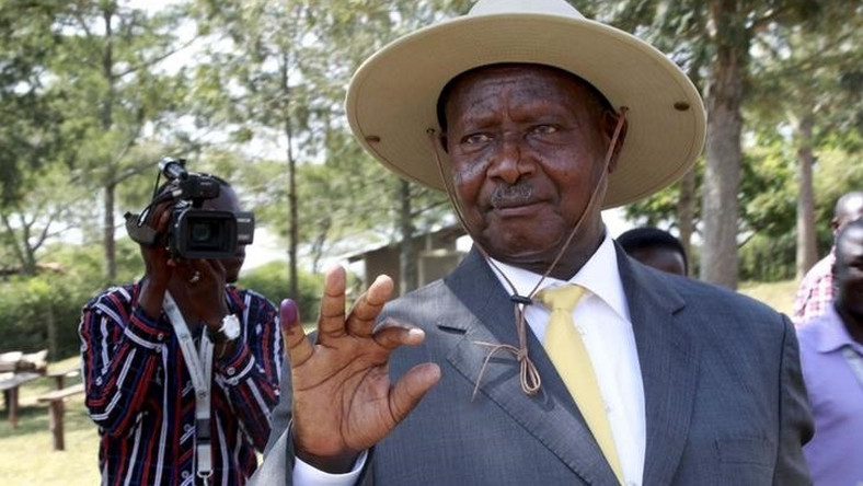 Uganda's incumbent President Yoweri Museveni displays his inked finger after casting his vote at a polling station during the presidential elections in Kirihura in western Uganda, February 18, 2016. REUTERS/James Akena