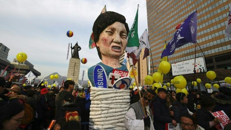 Protesters carry an effigy of South Korea's President Park Geun-Hye during a rally in Seoul, on December 3, 2016