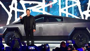 Tesla CEO Elon Musk stands in front of the Cybertruck during its unveiling on November 21, 2019.
