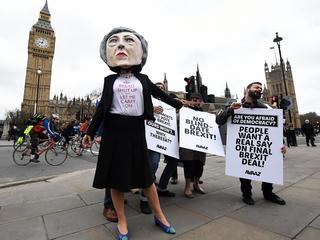 Pro EU protesters demonstrate against Brexit outside parliament