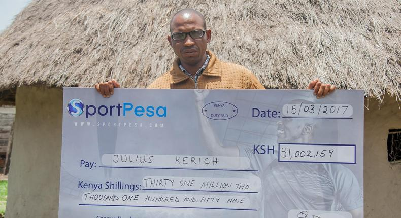 Julius Kerich poses with his Sh31million Sportpesa dummy cheque.