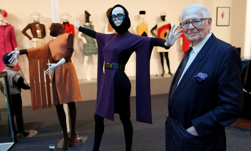FILE PHOTO: French fashion designer Pierre Cardin poses in front of his fashion creations in his mus