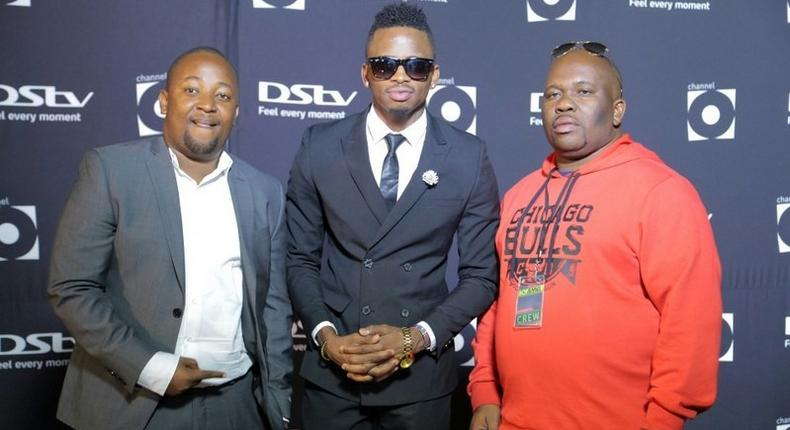 Diamond with his managers Mkubwa Fella and Babu Tale. Diamond's manager pens down emotional message to people trying to kidnap his children