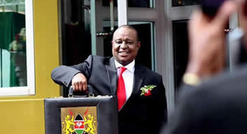 Finance Cabinet Secretary Henry Rotich poses with the traditional budget briefcase outside Parliament