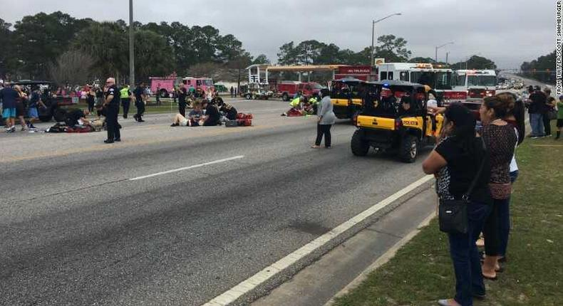 Emergency crews respond to the scene of the parade, which was canceled
