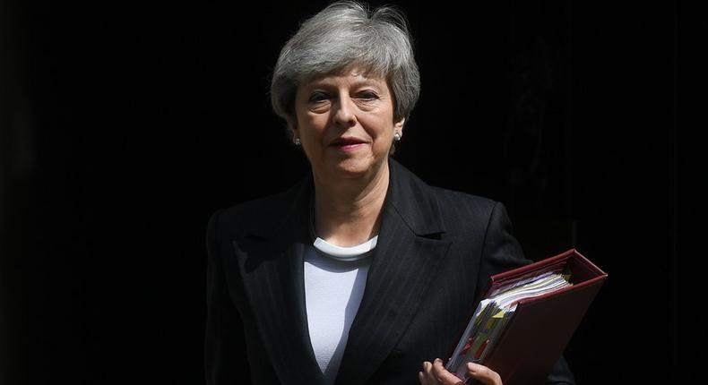May faces calls to quit amid fresh Brexit revolt and a resignation