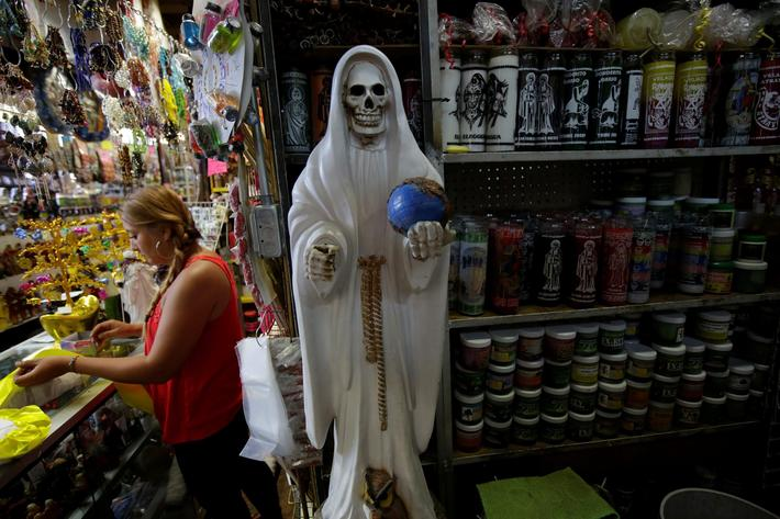 Figure depicting La Santa Muerte (Saint Death) is pictured at a stall of religious ornaments in Ciud